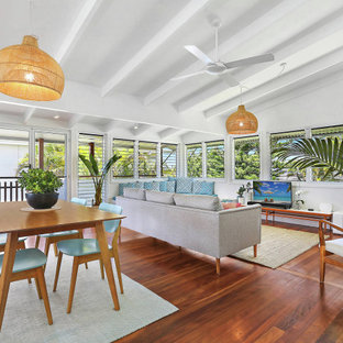 Mid-sized beach style open concept living room in Sunshine Coast with white walls, dark hardwood floors and brown floor.