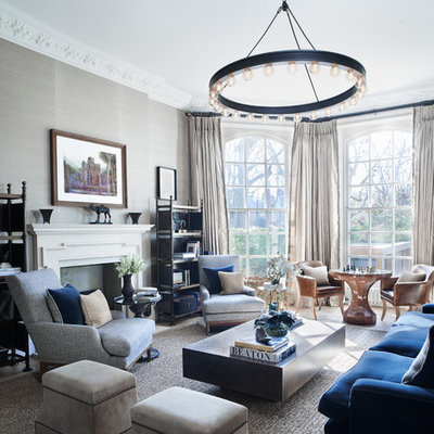 Inspiration for a large transitional formal living room remodel in London with gray walls, a standard fireplace and no tv