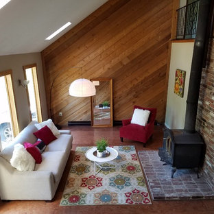 Inspiration for a mid-sized country formal open concept living room in Philadelphia with cork floors, a wood stove, a brick fireplace surround, beige walls, no tv and brown floor.