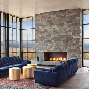 Living room - large contemporary open concept dark wood floor and brown floor living room idea in Denver with a ribbon fireplace and a stone fireplace