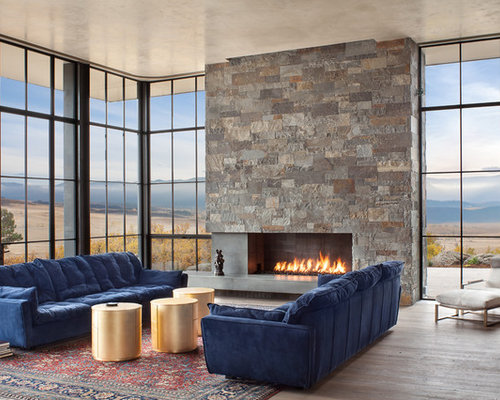 large contemporary open concept living room idea in denver with a ribbon fireplace a stone