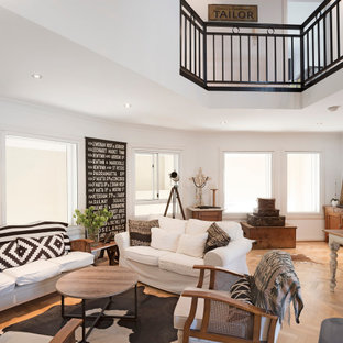 Eclectic living room in Sydney with white walls, medium hardwood floors and brown floor.