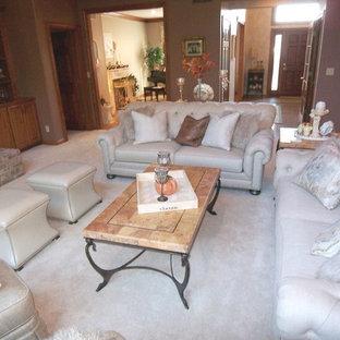 Ejemplo de salón abierto, actual, grande, sin televisor, con paredes marrones, moqueta, chimenea tradicional, marco de chimenea de ladrillo y suelo blanco