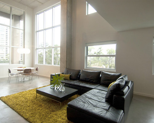 Trendy Living Room Photo In Houston With White Walls And Concrete Floors