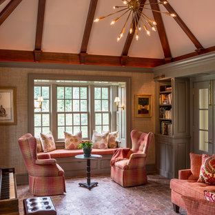 Living room library - large traditional enclosed terra-cotta floor living room library idea in Philadelphia with beige walls