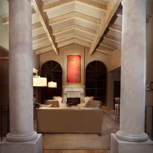 Large elegant formal and open concept terra-cotta floor living room photo in Phoenix with beige walls, a standard fireplace, a stone fireplace and no tv