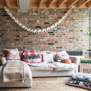 Design ideas for a medium sized rustic enclosed living room in London with light hardwood flooring.