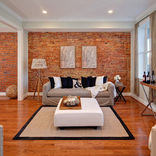 Example of an eclectic medium tone wood floor and orange floor living room design in DC Metro