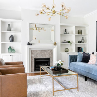 Design ideas for a large transitional formal open concept living room in Sydney with white walls, medium hardwood floors, a standard fireplace, a tile fireplace surround, no tv and brown floor.