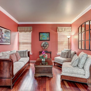 Photo of a small contemporary living room in DC Metro with red walls and medium hardwood floors.
