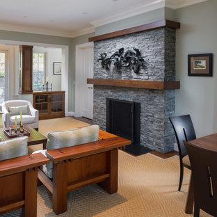 Imagen de salón para visitas abierto, de estilo americano, extra grande, sin televisor, con paredes verdes, suelo de madera en tonos medios, chimenea tradicional, marco de chimenea de piedra y suelo marrón