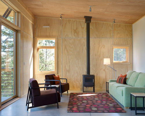 Example Of A Minimalist Concrete Floor Living Room Design In Seattle With A  Wood Stove Part 38