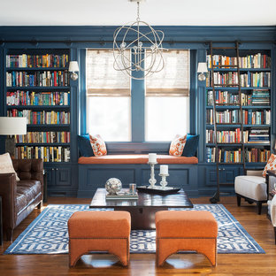 Inspiration for a classic living room in New York with a reading nook, blue walls, medium hardwood flooring and no tv.