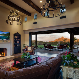 Inspiration for a large southwestern open concept porcelain floor and brown floor living room remodel in Phoenix with a standard fireplace and a plaster fireplace