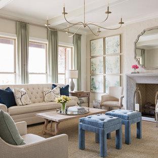 Immagine di un soggiorno chic con sala formale, pareti beige, pavimento in legno massello medio, camino classico, cornice del camino in pietra e nessuna TV