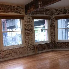 Modern Living Room by J & M Remodel and Repair