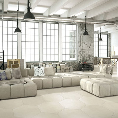 Huge urban open concept ceramic tile living room photo in Manchester with gray walls