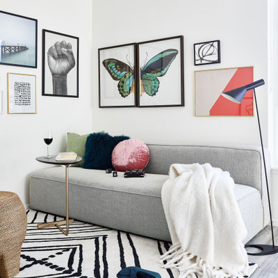 Small trendy open concept gray floor and vinyl floor living room photo in San Francisco with white walls and a wall-mounted tv