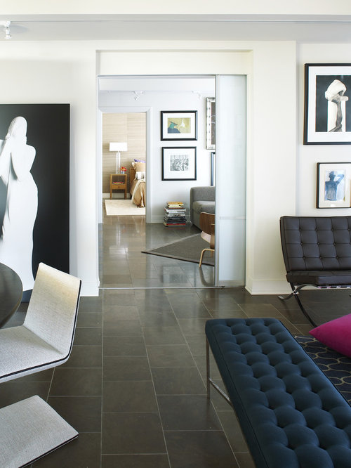 Example Of A Minimalist Limestone Floor And Black Living Room Design In Atlanta