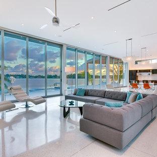 Ispirazione per un ampio soggiorno moderno aperto con sala formale, pareti bianche, pavimento con piastrelle in ceramica, nessun camino e nessuna TV