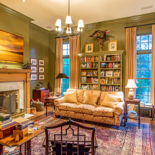 Living room - traditional formal and enclosed medium tone wood floor living room idea in Other with green walls, a standard fireplace and no tv