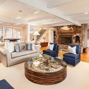 Living room - mid-sized beach style medium tone wood floor living room idea in Boston with beige walls, a standard fireplace and a stone fireplace