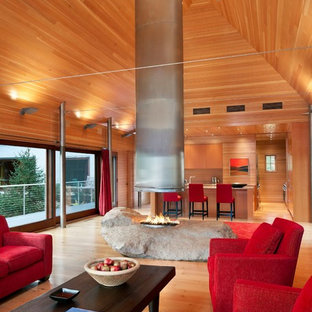 Contemporary open concept living room in Portland Maine with a two-sided fireplace.