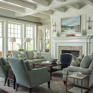 This is an example of a large traditional formal enclosed living room in Jacksonville with green walls, medium hardwood floors, a standard fireplace, a stone fireplace surround and no tv.