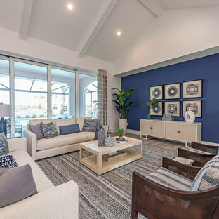 Example of a coastal gray floor living room design in Miami with blue walls