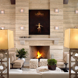 Example of a trendy living room design in Nashville with beige walls and a standard fireplace