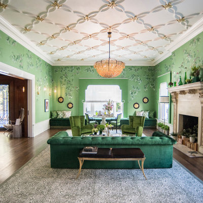 Eclectic formal and enclosed dark wood floor living room photo in Seattle with green walls, a standard fireplace and a stone fireplace