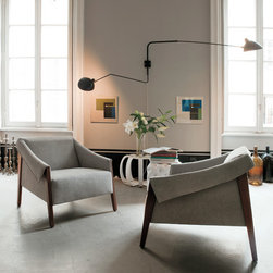 Porada Wood Furnishings - The Ara armchair by Porada is an easychair with a solid frame in ash or walnut and removable cover. Available in a multitude of fabrics.