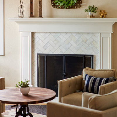 Living room - mid-sized transitional formal and open concept light wood floor and brown floor living room idea in Denver with beige walls, a standard fireplace, a tile fireplace and no tv