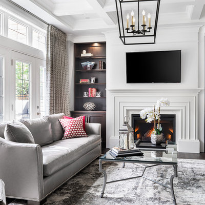 Mid-sized trendy formal and enclosed dark wood floor living room photo in Toronto with a standard fireplace, a plaster fireplace, a wall-mounted tv and white walls