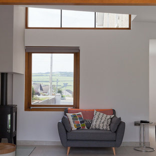 This is an example of a medium sized contemporary open plan living room in Other with white walls, ceramic flooring, a wood burning stove and a wall mounted tv.