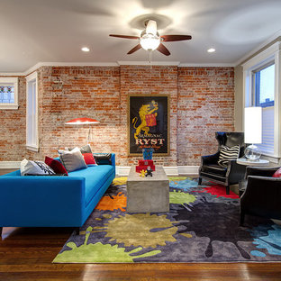 Inspiration for a mid-sized modern open concept dark wood floor and brown floor living room remodel in St Louis with gray walls and no tv