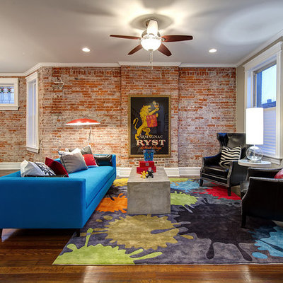 Inspiration for a mid-sized modern open concept dark wood floor and brown floor living room remodel in St Louis with gray walls, no tv and no fireplace
