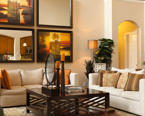 Large Wall Design Ideas example of a cottage chic dining room design in south east with white walls and a Trendy Living Room Photo In Houston With Beige Walls