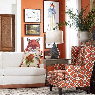ミルウォーキーのトラディショナルスタイルのおしゃれな独立型リビング (フォーマル、オレンジの壁、カーペット敷き) の写真