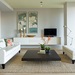 Living room - modern living room idea in Portland with gray walls and a tv stand