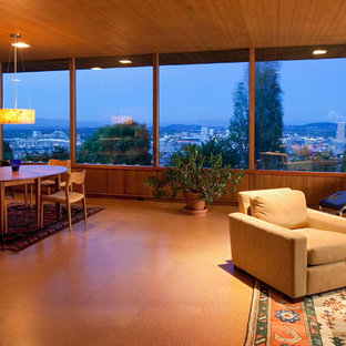 Living room - mid-sized 1950s enclosed and formal cork floor living room idea in Portland with no tv, white walls, a standard fireplace and a stone fireplace