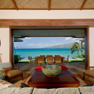Inspiration for a mid-sized tropical open concept living room remodel in Hawaii with white walls