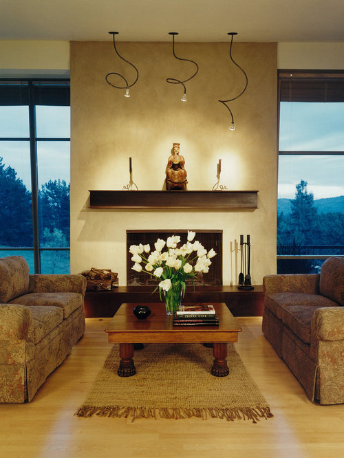 fireplace mantel lighting. rustic living room idea in san francisco with beige walls a standard fireplace and mantel lighting