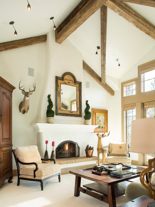 Refinishing Fireplace Part - 35: Example Of A Mountain Style Formal Carpeted Living Room Design In Denver  With White Walls And