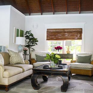 ワシントンD.C.の中サイズのビーチスタイルのおしゃれなLDK (白い壁、コンクリートの床、壁掛け型テレビ、グレーの床) の写真