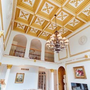 フィラデルフィアの大きいトラディショナルスタイルのおしゃれなLDK (フォーマル、白い壁、大理石の床、標準型暖炉、石材の暖炉まわり、壁掛け型テレビ) の写真