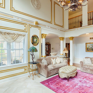 Photo of a large traditional formal open concept living room in Philadelphia with white walls, marble floors, a standard fireplace, a stone fireplace surround and a wall-mounted tv.