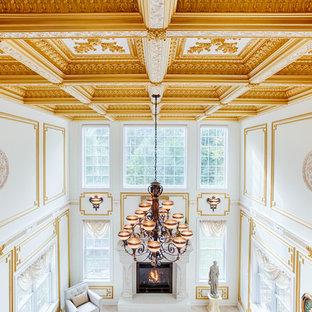 フィラデルフィアの大きいトラディショナルスタイルのおしゃれなLDK (フォーマル、白い壁、標準型暖炉、石材の暖炉まわり、壁掛け型テレビ、大理石の床) の写真