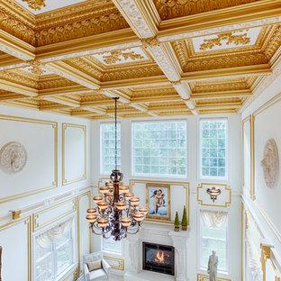 フィラデルフィアの広いトラディショナルスタイルのおしゃれなLDK (フォーマル、白い壁、大理石の床、標準型暖炉、石材の暖炉まわり、壁掛け型テレビ) の写真