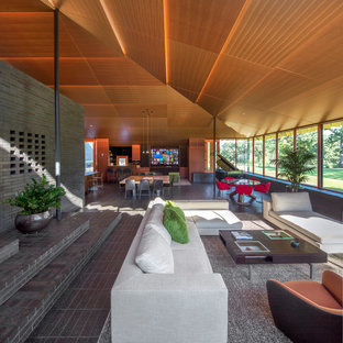 Inspiration for a 1950s open concept gray floor living room remodel in Oklahoma City with gray walls